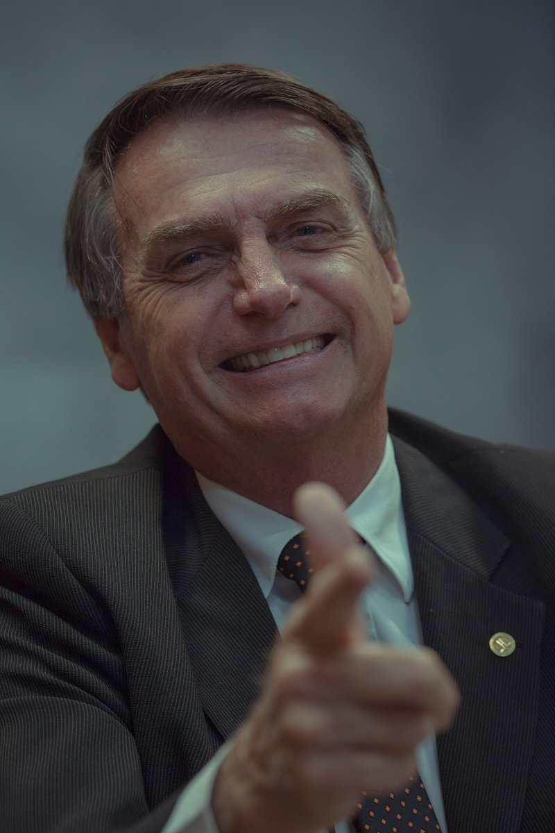 A strong defender of police officers who kill criminals, Jair Bolsonaro makes his iconic gesture of imitating a weapon with his hand