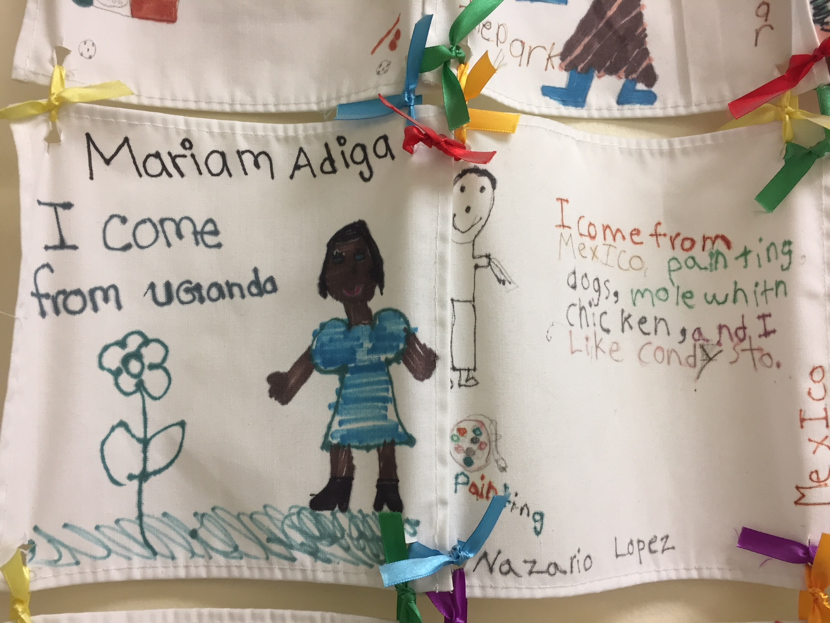 Posters from immigrant children shown at the Chicago office of World Relief